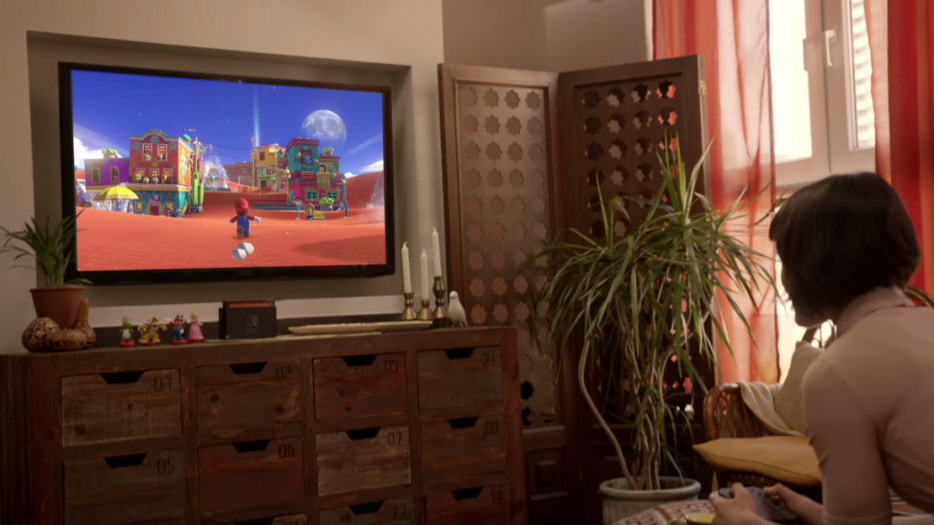 the-trailer-shows-a-woman-playing-a-new-mario-game-on-her-couch-it-looks-like-it-has-an-open-world-setting